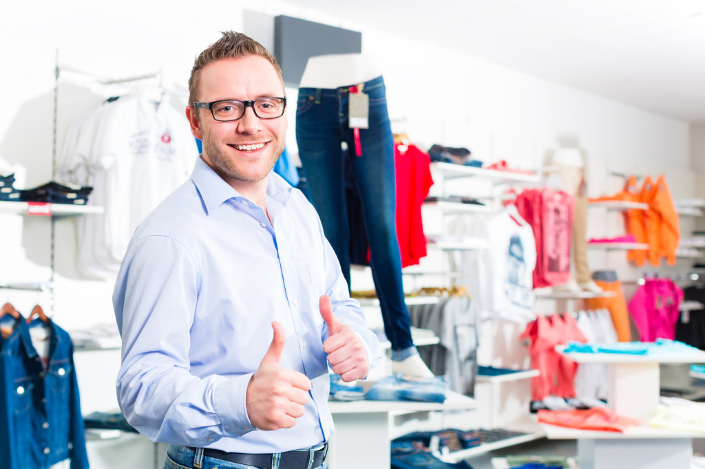 Handsome Man buying blue jeans in shop or store